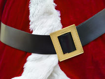 Santa Claus belt. Closeup of a red Santa Claus costume with belt and buckle stock image