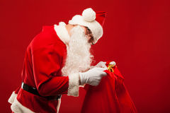 Santa claus with big bag on shoulder glasses  red Royalty Free Stock Photo