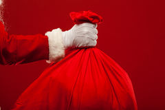 Santa claus with big bag on shoulder glasses  red Stock Photo
