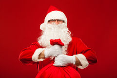 Santa claus with big bag on shoulder glasses  red Royalty Free Stock Photography