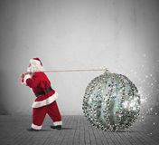 Santa Claus with big Christmas ball Royalty Free Stock Photography