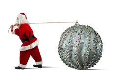 Santa Claus with big Christmas ball Stock Photos