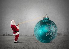 Santa Claus with big Christmas ball Stock Photo