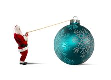 Santa Claus with big Christmas ball Royalty Free Stock Images