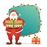 Santa Claus with big gift for Merry Christmas. Royalty Free Stock Images