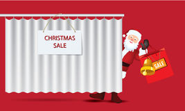 Santa Claus with big sale paper bag behind curtain Stock Photo
