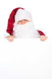 Santa Claus with big white beard looking over blank poster. royalty free stock photos