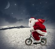 Santa claus on the bike. In the mountains