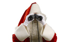 Santa Claus with binoculars looking around, searching for... stock video footage