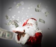 Santa Claus blåser dollar Fotografering för Bildbyråer