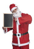 Santa claus and blackboard Stock Images