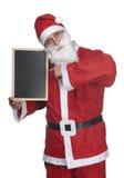 Santa claus and blackboard stock images