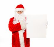 Santa Claus with blank notice board Stock Photo