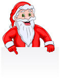 Santa Claus with a Blank Sign. Santa Claus is indicating to a blank banner. Anyone can write the text here Stock Photo