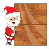 Santa Claus with blank wood plank for your massage. Full color Royalty Free Stock Image