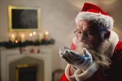 Santa Claus Blowing Kiss royalty-vrije stock foto
