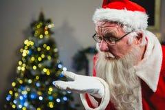 Santa Claus Blowing Kiss stock afbeelding