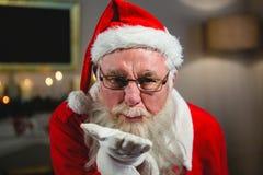 Santa Claus Blowing Kiss stock foto