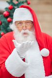 Santa Claus Blowing Kiss Outdoors Royalty Free Stock Images