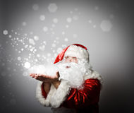 Santa Claus is blowing. Miracle concept. Santa Claus is blowing. With best wishes for the New Year. Miracle concept Royalty Free Stock Photos