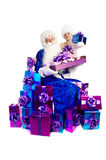 Santa Claus in blue with lots of presents Royalty Free Stock Photography