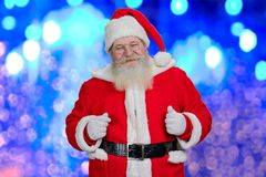 Santa Claus on blue shiny background. Royalty Free Stock Photos