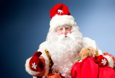 Santa Claus on blue background. Royalty Free Stock Images