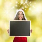Santa claus with board Stock Photos