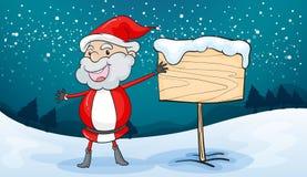 Santa claus and board Royalty Free Stock Photos