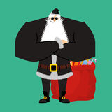 Santa Claus bodyguards. Christmas security guards. Protecting re Royalty Free Stock Image