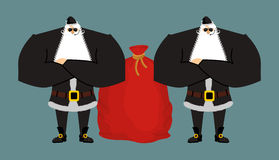 Santa Claus bodyguards. Christmas security guards. Protecting re Royalty Free Stock Photography