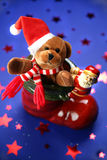 Santa claus boot with festive teddy royalty free stock image