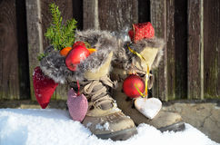 Santa Claus Boots in the snow Stock Photo