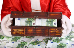 Santa Claus with box of money. Santa Claus with box of euro banknote Royalty Free Stock Image