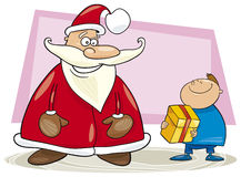 Santa claus and boy with gift Royalty Free Stock Photos