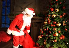 Santa Claus bring the sack with gifts for Christmas. Royalty Free Stock Photos