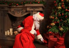 Santa Claus bring the sack with gifts for Christmas. Stock Photos