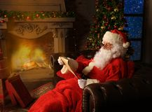 Santa Claus bring the sack with gifts for Christmas. Royalty Free Stock Images