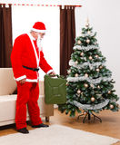 Santa Claus bringing gas as present. Santa Claus bringing gas can full of benzine as Christmas Gift Royalty Free Stock Images