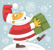 Santa Claus bringing present Royalty Free Stock Image