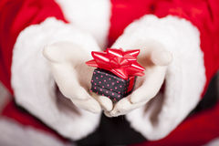 Santa Claus brings Christmas gift Stock Images