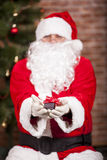 Santa Claus brings Christmas gift Royalty Free Stock Image