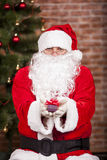 Santa Claus brings Christmas gift Royalty Free Stock Images