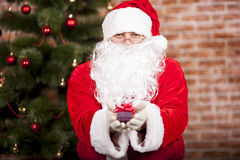 Santa Claus brings Christmas gift Stock Image