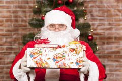 Santa Claus brings Christmas gift Stock Photos