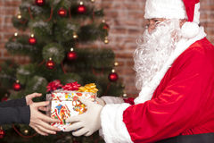Santa Claus brings Christmas gift Stock Photography