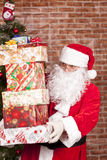 Santa Claus brings Christmas gifts Stock Images