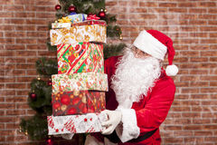 Santa Claus brings Christmas gifts Royalty Free Stock Image