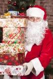 Santa Claus brings Christmas gifts. Near the Christmas tree Stock Image