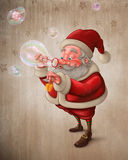 Santa Claus and the bubbles soap. Santa Claus put the gift box in to the soap bubbles Stock Photo